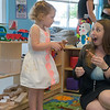 Charity Oakes, classroom development mentor, plays with Lakynn Abbott, 2, in the new Ewert Park Early Head Start building on Wednesday.<br /> Globe | Roger Nomer