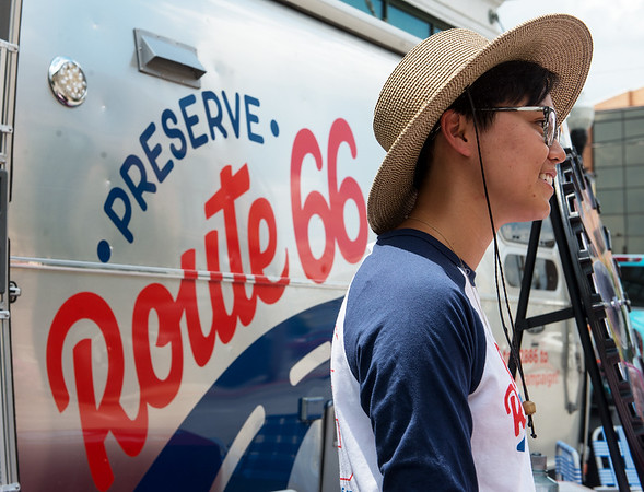Lina Tran, a roadie with the National Trust for Historic Preservation, welcomes visitors to the Route 66 Airstream trailer on Tuesday at Joplin City Hall.<br /> Globe   Roger Nomer