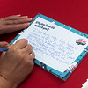 Audrey Worley, Joplin, writes a postcard of support for Route 66 on Tuesday at Joplin City Hall.<br /> Globe | Roger Nomer