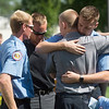 J. Ryan Wood, right, comforts his fellow Western Taney County first responders embrace following Sunday's memorial service at the College of the Ozarks. Many of the first responders attending worked the boat accident on Table Rock Lake on Thursday.<br /> Globe | Roger Nomer