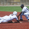 Hitters Baseball Navy's Rhay Street tags out Rawlings Arkansas Prospects Roberson's Dylan Carter on a steal during Thursday's game at Joe Becker Stadium.<br /> Globe | Roger Nomer