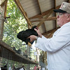 Kenneth Conaway judges poultry at the Jasper County Youth Fair on Wednesday.<br /> Globe | Roger Nomer