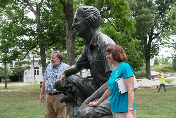 America in Bloom judges Devereaux Bemis and Kristin Pategas pose for a photo with the Marlon Perkins statue in Central Park in Carthage on Thursday.<br /> Globe   Roger Nomer