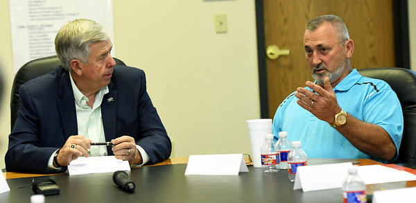Goodman Mayor Greg Richmond, right,  discusses the post tornado challenges facing his community as Missouri Governor Mike Parson, right, listens during a roundtable discussion with mayors from Jasper County on Tuesday at Joplin City Hall. Topics discussed included infrastructure and work force development.<br /> Globe | Laurie Sisk