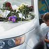 Saylor Lembke, 8, Kansas City, Mo., bows her head for prayer by an abandoned car at the Ride the Ducks attraction on Friday in Branson.<br /> Globe | Roger Nomer