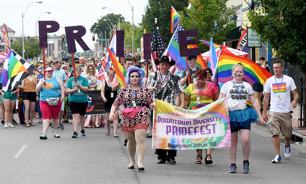 Members of the LGBTQ community and their allies march down Joplin Ave. as part of the Downtown Diversity Pridefest organized by JOMO Pride, Inc. on Saturday. The day-long event featured entertainment, food, political action booths and more.<br /> Globe   Laurie Sisk