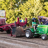 """5 year old Ryan Seedorf on board of the """"Pullin' Princess"""" sled receives instructions from sled owner Scott Potter during the tractor and pickup pull fund raiser sponsored by Carthage Shrine Club on Saturday evening.<br /> Israel Perez