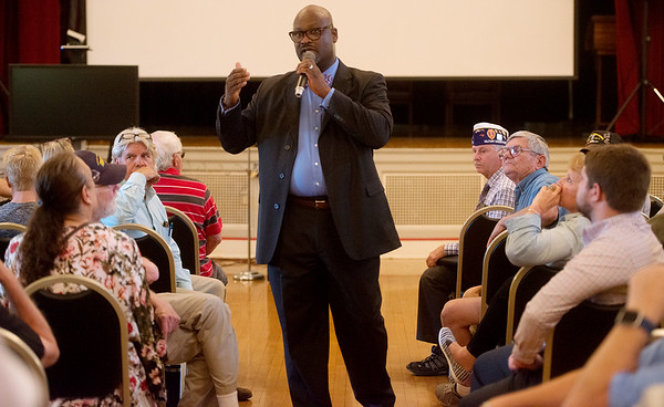 Kelvin Parks, interim director of the Veterans Health Care System of the Ozarks, answers a question during a town hall on Monday at the clinic.<br /> Globe   Roger Nomer