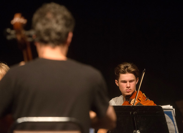 Nick Ward, 15, Kansas City, practices chamber music with the Next Generation Performing Arts Camp at Missouri Southern on Wednesday.<br /> Globe | Roger Nomer