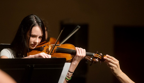 Chenoa Bentley, 14, Edmond, gets a gentle repositioning while playing at the Next Generation Performing Arts Camp on Wednesday at Missouri Southern.<br /> Globe   Roger Nomer