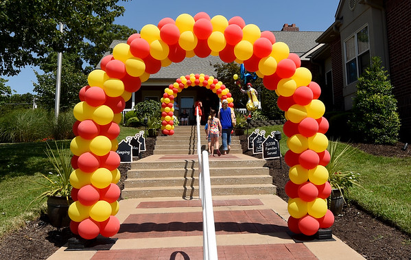 Guests enter under a festive array of balloons at the start of the Ronald McDonald of the Four States 20th Birthday celebration on Friday at RMH. The event featured games, food vendors, music and more.<br /> Globe | Laurie Sisk