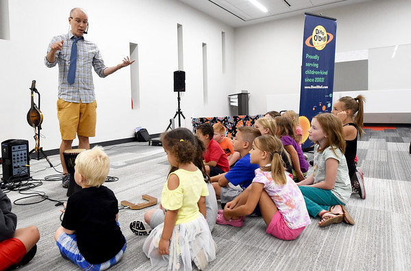 Author and musician Dino O'Dell, left, presents a special program on different types of instruments on Tuesday at the Joplin Public Library. O'Dell offers education through interactive experience during his family-based shows.<br /> Globe   Laurie Sisk