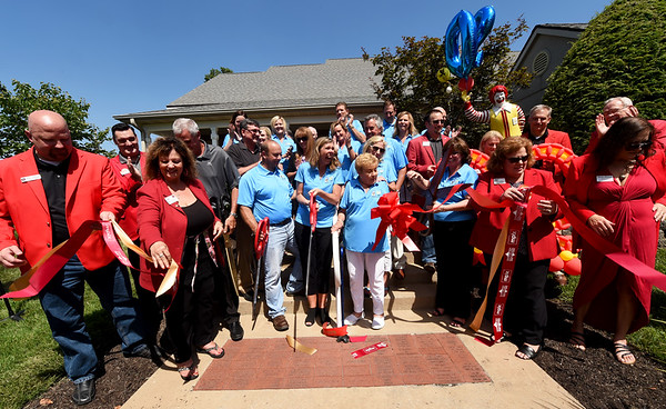 Ronald McDonald House staff, volunteers and representatives from several area Chambers of Commerce celebrate the 20th Birthday of the RMH on Friday.<br /> Globe | Laurie Sisk