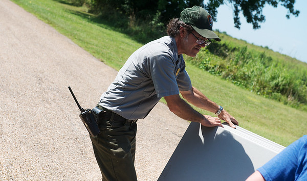 Chris Reed, facilities manager, sets up tables for Carver Day at the Carver National Monument on Friday.<br /> Globe   Roger Nomer