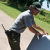 Chris Reed, facilities manager, sets up tables for Carver Day at the Carver National Monument on Friday.<br /> Globe | Roger Nomer