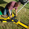 Michael Sneed prepares an agriculture drone for a demonstration at the Four State Farm Show on Friday in Pittsburg.<br /> Globe | Roger Nomer