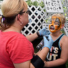 Airbrush artist Gaisa Westervelt, of Color Me Crazy, uses her talents to transform 7-year-old Clayton Bunn, of Anderson, from a boy into a cheetah on Friday during Food Truck Friday at Carthage's Central Park.<br /> Globe | Laurie Sisk