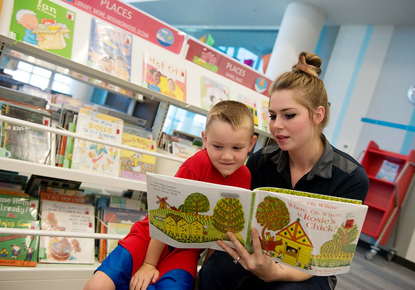 Amanda and Wyatt, 5, Peterson look at a book at the Joplin Public Library on Tuesday.<br /> Globe | Roger Nomer