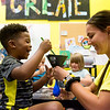 Maggie Johnson and Jemari Gilmore, 6, make a craft at the Boys and Girls Club of Southwest Missouri on Monday.
