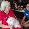 Eddie Lyons, with her dog Priscilla, talks with Casie Ouren, Neighbor Connect coordinator with Watered Gardens, at her apartment in Mercy Village on Thursday.<br /> Globe | Roger Nomer
