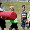 From the left: Morgin Smiles, of the 4-State Fusion football team, supervises blocking drills with Brianna Belk, 12, of Joplin as McCoy Jones, 10, of Frontenac and Adrianna Wagner, 12, of Duenweg look on Saturday during the Fusion's Bill Burton Memorial Youth Camp at Landreth Park. More than 20 area youth from 3rd to 8th grade participated in the camp.<br /> Globe | Laurie Sisk