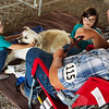 Twins Morgan, left, and Madison Duling, 8, Galena, talk with Peyton Herrenbock, 15, Baxter Springs, and his dog Daizee at the Cherokee County Fair on Tuesday in Columbus.<br /> Globe | Roger Nomer