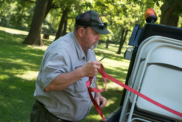 James Sullivan, maintenance, helps set up chairs for Carver Day on Friday at the Carver National Monument.<br /> Globe | Roger Nomer