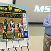 Missouri Southern Head Coach Denver Johnson applauds as a rendering of the new video scoreboard is revealed during a press conference Thursday at MSSU.<br /> Globe | Roger Nomer