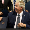 Missouri Gov. Mike Parson smiles after signing Missouri House Bill 2540 into law on Thursday at Hartman & Co. in Springfield. The plan lowers Missouri's personal income tax rate from 5.9 percent to 5.5 percent effective Jan. 1. and allows personal income tax rates to to dip to 5.1 percent if the state hits revenue targets in the future.<br /> Globe | Laurie Sisk