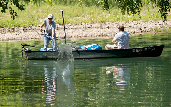 Officials from the Missouri Department of Natural Resources on Wednesday morning search a pond southwest of Lone Elm and Zora roads to try and locate the body of Tracy Pickett, who was presumed murdered in 1992.<br /> Globe | Laurie Sisk