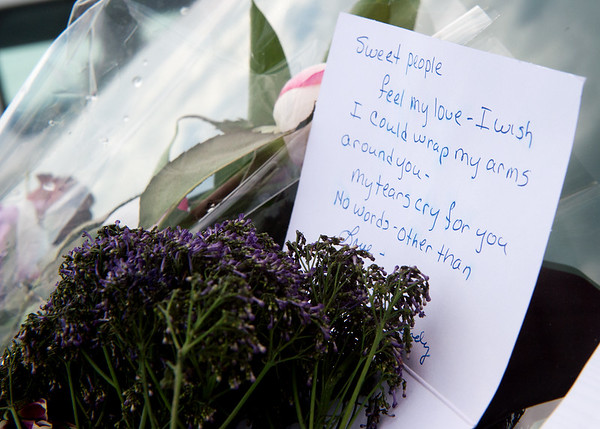 Handwritten notes and flowers are left on the windshields of the victims of the duck boat accident in Branson on Friday.<br /> Globe | Roger Nomer