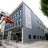 Construction continues on the Block 22 project on Thursday in downtown Pittsburg. Pictured is an historic mural tieing the downtown area to Pittsburg State tradition.<br /> Globe | Laurie Sisk