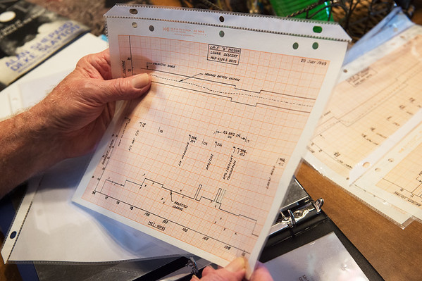 Carroll Wheat talks about his graphs tracking the performance of batteries during the Apollo 11's lunar descent during an interview on Tuesday.<br /> Globe | Roger Nomer