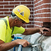 James Routh, with Mid-Continental Restoration, works on masonry at the Schifferdecker House on Wednesday.<br /> Globe | Roger Nomer