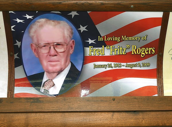 "A poster memorializing Fred ""Fritz"" Rogers hangs inside Streetcar No. 60 last week at King Jack Park in Webb City. The late Rogers was a primary force in getting the trolley as a staple of the park.<br /> Globe 