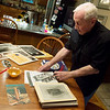 Rex Erisman talks about photos of batteries used in the Apollo 11 mission during an interview on July 10.<br /> Globe | Roger Nomer