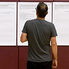 Blake Webster looks at posters detailing options for Columbia and West Central Elementary schools before the start of a public input forum on the fate of the two schools on Thursday night at Columbia Elementary. The forum was one of several conducted during the week.<br /> Globe | Laurie Sisk
