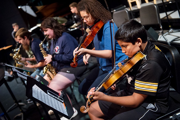 Students, including Eann Espinoza, 12, right, and Jaden Taylor, 15, practice a song during the Joplin Jazz Camp on Wednesday at Thomas Jefferson Independent Day School. Camp musicians will present a jazz concert today at noon at the school.<br /> Globe | Roger Nomer