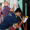 Davis Kuriakos, a KCU first-year student from Oklahoma City, Okla., and Chris Woitowitz, IT manager at KCU, work on a mural in downtown Joplin during Wednesday's KCU Cares Day.<br /> Globe | Roger Nomer