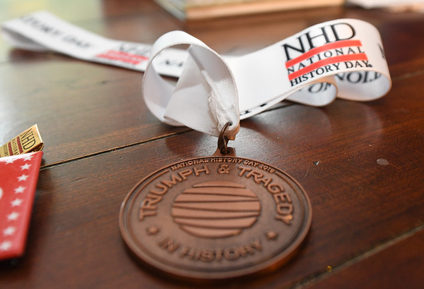 Thirteen-year-old documentary filmmaker Josef Schuller's National History Day medal he received after entering his documentary on the Korean War sits on a table at his Joplin home. The award winning documentary centers on action at Funchilin Pass.<br /> Globe | Laurie Sisk