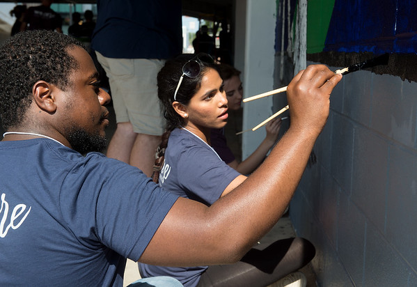 Tevin Hughley, a KCU first-year student from Opelika, Ala., and Parshvi Patel, a first-year student from Corona, Calif, work on a mural in downtown Joplin on Wednesday during the KCU Cares Day.<br /> Globe | Roger Nomer