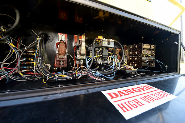 """A look """"under the hood"""" reveals the intricate wiring for Streetcar No. 60's new switch engine last week at King Jack Park in Webb City. The trolley recently received the new engine courtesy of Rick Webb of Watco.<br /> Globe 