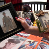 "Gold Star mom Teresa Cleaver holds portraits of her son, SSG John Cleaver as a soldier in Afghanistan, let and as a youg boy with a friend, ""playing Vietnam."" SSG John Cleaver was killed in Afghanistan in 2009. <br /> Globe 