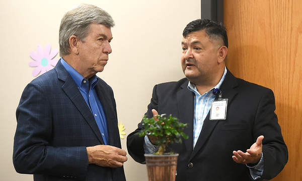 Sen. Roy Blunt chats with Access Famiy Care Chief Business Officer John Smith during Blunt's tour of the newly expanded clinic on Friday. Access has recently added 26 new exam rooms as part of a partnership with Kansas City University of Medicine and Biosciences.<br /> Globe | Laurie Sisk
