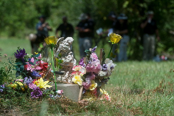 A memorial to Ashley Freeman and Lauria Bible is seen at a site in Picher.<br /> Globe | Roger Nomer