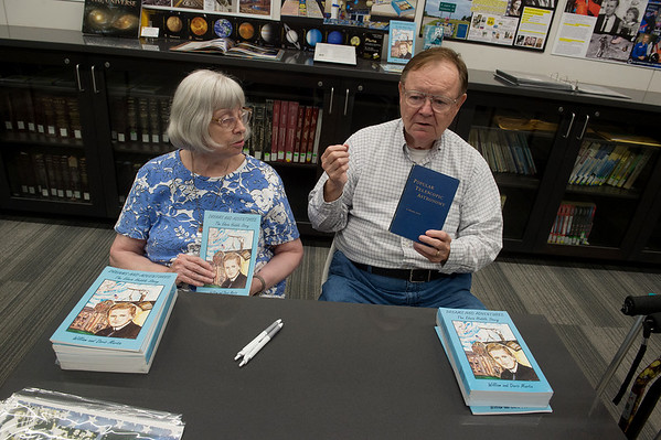 "Doris and William Martin talk about their book ""Dreams and Adventures:  The Edwin Hubble Story"" and another book on telescopic astronomy used by Hubble during their book signing at the Joplin Public Library on Monday.<br /> Globe 