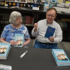"""Doris and William Martin talk about their book """"Dreams and Adventures:  The Edwin Hubble Story"""" and another book on telescopic astronomy used by Hubble during their book signing at the Joplin Public Library on Monday.<br /> Globe   Roger Nomer"""