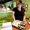 Local business owner Heather Horton works inside her Pittsburg business, Sweet Designs Cakery, 311 N. Broadway on Friday. Horton, like many Pittsburg business owners, is concerned taggers may be damaging historic buildings in Pittsburg.<br /> Globe | Laurie Sisk