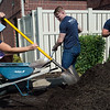 (from left) Katelyn Parmenter, a first-year KCU student from Evansville, Ind., Tyler Bullock, a first-year student from Fair Hope, Ala., and Kyle Lipa, a first-year student from Eklhart, Ind., work with mulch at the Ronald McDonald House during Wednesday's KCU Cares Day.<br /> Globe | Roger Nomer