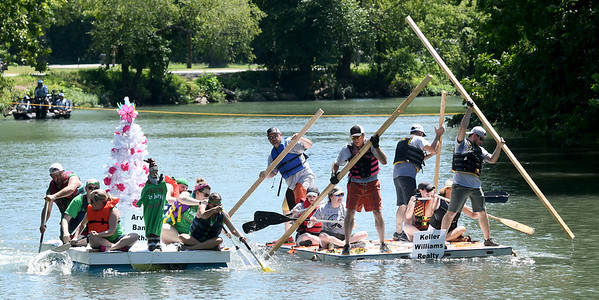 From the left: Teams from Arvest Bank and Keller Williams Realty battle it out for the right to advance in the brackets during the Carthage Paddle Battle on Saturday at Kellogg Lake Park. In addition to the fastest craft, awards were presented for most creative craft, best theme with a costume, most likely to sink and a $500 audience choice award. The inaugural event was sponsored by Smith Midwest Real Estate.<br /> Globe | Laurie SIsk